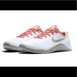 Pink and white Nike metcons